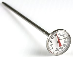A thermometer holds the measurement of the temperature.